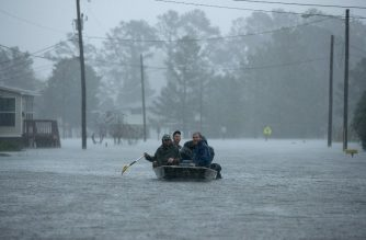 NEW BERN, NC - SEPTEMBER 14: Volunteers from all over North Carolina help rescue residents from their flooded homes during Hurricane Florence September 14, 2018 in New Bern, North Carolina. Hurricane Florence made landfall in North Carolina as a Category 1 storm and flooding from the heavy rain is forcing hundreds of people to call for emergency rescues in the area around New Bern, North Carolina, which sits at the confluence of the Nuese and Trent rivers. The storm has since been downgraded to a tropical storm.   Chip Somodevilla/Getty Images/AFP
