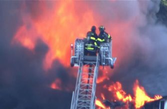 Firemen at the scene of the gas explosions in the US towns north of Boston that began Thursday afternoon, Sept. 13, 2018.  (Photo grabbed from AFP video)