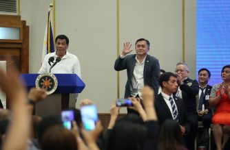 President Rodrigo Duterte speaks before Overseas Filipino Workers in Israel. Special Assistant to the President Bong Go waves as he is introduced by Duterte to the audience./RTVM/