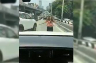 The woman who was seen dancing on Edsa in a viral video has apologized./Screenshot from video/