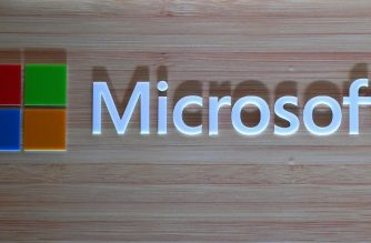 The logo of Microsoft is pictured during the launch of Surface Book 2 and Surface Laptop at a promotional event in New Delhi on August 7, 2018. (Photo by Sajjad HUSSAIN / AFP)