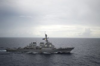 """(FILES) In this file photo taken on October 21, 2016, the guided-missile destroyer USS Decatur (DDG 73) operates in the South China Sea as part of the Bonhomme Richard Expeditionary Strike Group (ESG).  An American warship has sailed through waters off the contested Spratly Islands in the South China Sea, in the latest implicit challenge to Beijing's sweeping territorial claims in the region, the Pentagon said Sunday, September 30, 2018. """"Guided-missile destroyer USS Decatur conducted a freedom of navigation operation,"""" an official told AFP. """"Decatur sailed within 12 nautical miles of Gaven and Johnson reefs in the Spratly Islands."""" The official said all US military operations in the area """"are designed in accordance with international law and demonstrate that the United States will fly, sail and operate wherever international law allows."""" The 12-mile distance is commonly accepted as constituting the territorial waters of a landmass. Beijing claims all of the Spratly chain. There was no immediate reaction from China, but a similar US operation in July, involving the disputed Paracel islands, prompted a furious Beijing to deploy military vessels and fighter jets. / AFP PHOTO / Navy Media Content Operations (N / Petty Officer 2ndClass Diana QUINLAN / RESTRICTED TO EDITORIAL USE - MANDATORY CREDIT """"AFP PHOTO / US NAVY/Petty Officer 2nd Class Diana Quinlan"""" - NO MARKETING NO ADVERTISING CAMPAIGNS - DISTRIBUTED AS A SERVICE TO CLIENTS"""