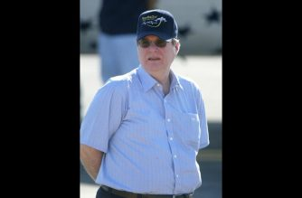 (FILES) In this file photo taken on June 21, 2004 (FILES) SpaceShipOne financier Paul Allen on the tarmac following the successful landing of SpaceShipOne on the world's first commerical manned space flight, at Mojave Airport in California.  Billionaire Paul Allen, co-founder in 1975 with Bill Gates of US IT giant Microsoft, must once again fight a cancer that was already treated in 2009 but has recurred, he said on Monday, October 1, 2018.  / AFP PHOTO / AFP FILES / Robyn BECK