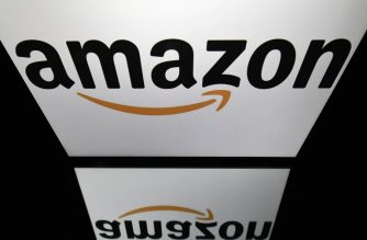 (FILES) In this file photo taken on April 19, 2018 shows the logo of online retail comapny Amazon displayed on a tablet screen in Paris.  Online retail giant Amazon announced on October 2, 2018 it would raise its starting wage for US workers to $15 an hour, amid long-standing criticism of low pay, and advocate for a higher minimum wage nationwide.The pay raise will apply to 250,000 employees, starting November 1, and to the more than 100,000 seasonal workers the company expects to hire for the holiday shopping season.   / AFP PHOTO / Lionel BONAVENTURE