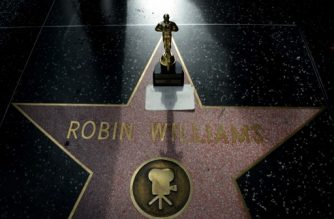 "(FILES) In this file photo taken on August 11, 2014 A minature Oscars statue and an ""I will miss you"" note is seen at Robin Williams' star on the Hollywood Walk of Fame is seen in Hollywood, California.  Art, film memorabilia and personal effects owned by the late actor Robin Williams and his wife fetched $6.1 million at auction in New York on Thursday, October 4, 2018, four years after his death, Sotheby's said. / AFP PHOTO / Mark RALSTON"