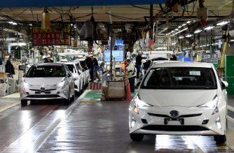 (FILES) This file photo taken on December 8, 2017 shows fourth generation Toyota Prius cars being driven from the production line at the company's Tsutsumi assembly plant in Toyota City, Aichi prefecture. Japanese car giant Toyota said on October 5, 2018 it is recalling more than 2.4 million hybrid cars over a fault that could cause crashes, just a month after an another recall affecting hybrids. / AFP PHOTO / Toshifumi KITAMURA