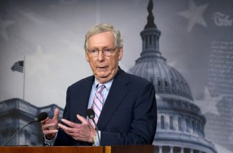 """(FILES) In this file photo taken on October 6, 2018 Senate Majority Leader Mitch McConnell, R-KY, speaks during a news conference following the confirmation vote of Supreme Court nominee Brett Kavanaugh on Capitol Hill in Washington DC. - US Senate leader Mitch McConnell on October 7, 2018 hailed the confirmation of divisive judge Brett Kavanaugh to the Supreme Court as his """"proudest moment"""" in the upper house as the warring Republicans and Democrats turned their focus to the crucial midterm elections.Kavanaugh was confirmed to the court Saturday by a razor-thin margin in the Senate, ending months of partisan rancor over his nomination and offering Donald Trump one of the biggest victories of his presidency. """"I'm proud of my colleagues, this is an important day for the United States Senate,"""" McConnell told political magazine show """"Fox News Sunday."""" (Photo by Jose Luis Magana / AFP)"""