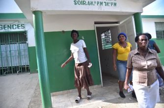 Pamelie Donne leaves the emergency room of Immaculate Conception Hospital, in Port-de-Paix, on October 7, 2018, after receiving treatment for injuries caused by the earthquake that struck northwestern Haiti, on October 6, 2018. Pamelie lost her son during the earthquake.  A 5.9-magnitude earthquake struck off the northwest coast of Haiti late Saturday, killing at least 12 people, injuring more than 130 others and damaging homes in the poverty-stricken Caribbean nation, authorities said.  / AFP PHOTO / HECTOR RETAMAL