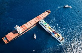 "This handout picture released on October 8, 2018 by the French Navy, Marine Nationale, shows a rescue boat ""Abeille Flandre"" approaching two cargo ships after they collided off the Mediterranean island of Corsica on October 7, 2018. French and Italian ships race on October 7, 2018 to contain a spreading oil spill after the Tunisian freighter (front) rammed into the Cyprus-based CSL Virginia vessel that was anchored about 30 kilometres (20 miles) off the northern tip of the French island. The ship's hull was pierced and at least one fuel tank began leaking into the nearby Cap Corse and Agriate marine reserve created just two years ago. / AFP PHOTO / French Marine Nationale / Alexandre Groyer / RESTRICTED TO EDITORIAL USE - MANDATORY CREDIT ""AFP PHOTO / MARINE NATIONALE""- NO MARKETING NO ADVERTISING CAMPAIGNS - DISTRIBUTED AS A SERVICE TO CLIENTS ---NO ARCHIVES AFTER NOVEMBER 8, 2018"