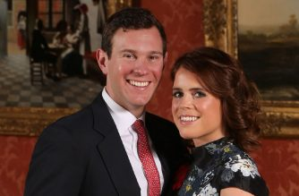 """(FILES) In this file photo taken on January 22, 2018 Britain's Princess Eugenie of York (R) poses with her fiance Jack Brooksbank in the Picture Gallery at Buckingham Palace in London on January 22, 2018, after the announcement of their engagement.  Five months on from Prince Harry and Meghan's fairytale nuptials, the time has come for """"the other"""" royal wedding -- the one no one seems to want to pay for or watch. When Queen Elizabeth II's granddaughter Princess Eugenie walks down the aisle on October 12, 2018 in Windsor Castle to marry Jack Brooksbank, a """"commoner"""" with blue-blood friends, the critics will be out.  / AFP PHOTO / POOL / Jonathan Brady"""