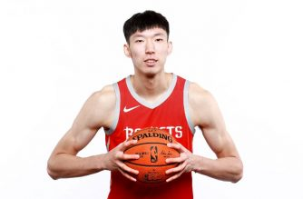 (FILES) In this file photo taken on September 24, 2018 Zhou Qi #9 of the Houston Rockets poses for a portrait during the Houston Rockets Media Day at The Post Oak Hotel at Uptown Houston in Houston, Texas. - Houston Rockets forward Zhou Qi is uncertain to be ready for next week's start of the NBA season after the Chinese center left the court in a wheelchair with a left knee injury. The 22-year-old 7-footer (2.17m) suffered the injury after playing only four minutes in Houston's 128-86 rout of the Shanghai Sharks in a pre-season exhibition contest the night of October 9, 2018. (Photo by TOM PENNINGTON / GETTY IMAGES NORTH AMERICA / AFP)