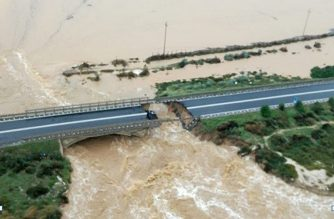 This handout aerial picture taken and released by the Guardia di Finanza, the Italian government's law enforcement agency, on October 10, 2018 shows a road bridge that collapsed after torrential rain caused a river to break its banks in Capoterra, near Cagliari in Sardinia. (Photo by Handout / Guardia di Finanza press office / AFP) / RESTRICTED TO EDITORIAL USE - MANDATORY CREDIT 'AFP PHOTO / HO / GUARDIA DI FINANZA' - NO MARKETING NO ADVERTISING CAMPAIGNS - DISTRIBUTED AS A SERVICE TO CLIENTS