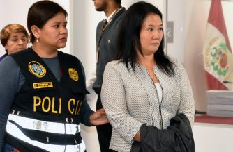 "Handout picture distributed by Peruvian Judiciary showing Keiko Fujimori, opposition leader and daughter of disgraced ex-president Alberto Fujimori, being escorted by police officers in a Judiciary office, in Lima, following her arrest on October 10, 2018, for alleged money laundering involving Brazilian construction giant Odebrecht. - The 43-year-old was arrested on the orders of prosecutors investigating contributions to her campaign when she ran for president in 2011, her lawyer Giuliana Loza said. (Photo by Juan Carlos VIVAS / Peruvian Judiciary / AFP) / RESTRICTED TO EDITORIAL USE - MANDATORY CREDIT ""AFP PHOTO /  PERUVIAN JUDICIARY-JUAN CARLOS VIVAS"" - NO MARKETING - NO ADVERTISING CAMPAIGNS - DISTRIBUTED AS A SERVICE TO CLIENTS"
