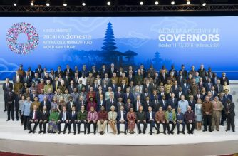 International Monetary Fund Managing Director Christine Lagarde (C-front) poses with finance ministers and Central Bank governors during a group photo at the International Monetary Fund (IMF) and World Bank annual meeting in Nusa Dua, on Indonesia's resort island of Bali on October 13, 2018. (Photo by Stephen Jaffe / International Monetary Fund / AFP)