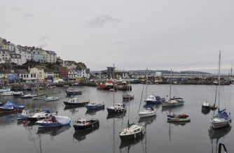 (FILES) In this file photo taken on March 26, 2018 Boats are seen in the harbour in the fishing town of Brixham on the south coast of England on March 26, 2018. - Tensions are already high between the French and British fishing fleets due to the scallop wars but Brexit could change the game completely by redrawing the battle lines in the Channel. French fishermen are anxious to avoid a hard Brexit that could shut them out of British territorial waters, while in UK ports, trawlermen hope such moves could reinvigorate the British fishing industry. (Photo by Joe JACKSON / AFP)