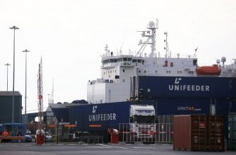 Unifeeder contrainers are seen at the Port of Immingham operated by Associated British Ports (ABP) on the south bank of the Humber Estuary, eastern England, on October 5, 2018. - Brexit has brought hope to the windswept docks of the Humber River, a key goods gateway in northeast England where tens of millions of pounds are being invested to prepare for a potential increase in shipping. Associated British Ports (ABP), which owns four Humberside facilities including vast Immingham complex, is spending big to attract new business, raising hopes for a return of the area's former industrial glory. (Photo by LINDSEY PARNABY / AFP)