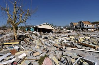 View of the damaged caused by Hurricane Michael in Mexico Beach, Florida, on October 13, 2018, in Mexico Beach, Florida, three days after Hurricane Michael hit the area. - Since Hurricane Michael roared through on October 10, a wide swath of Florida's northwest coast has been without telephone or Internet service, adding to the daunting challenges facing residents, loved ones trying to reach them, and the work crews struggling to bring them relief. A bridge was washed out between Mexico Beach and Port St. Joe to the southeast, making it impossible to get there via coastal roads (Photo by HECTOR RETAMAL / AFP)