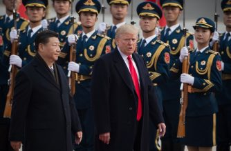 "(FILES) In this file photo taken on November 9, 2017 China's President Xi Jinping (L) and US President Donald Trump review Chinese honour guards during a welcome ceremony at the Great Hall of the People in Beijing. - US President Donald Trump and Chinese leader Xi Jinping will ""probably"" meet at a G20 summit next month, a US official said October 14, 2018, as both sides deplored a badly strained relationship that a Chinese official called ""very confusing."" ""The presidents will probably meet at the G20 in Buenos Aires,"" Trump economic adviser Larry Kudlow said on the ""Fox News Sunday"" program. (Photo by NICOLAS ASFOURI / AFP)"