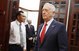 US Secretary of Defense Jim Mattis (R) arrives for a meeting with Ho Chi Minh City's communist party chief Nguyen Thien Nhan in Ho Chi Minh City on October 16, 2018. (Photo by KHAM / POOL / AFP)
