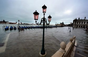"(FILES) This file photo shows Gondola's near St Mark's square flooded during ""acqua alta"" (high water) on November 1, 2012 in Venice. - From Venice and the tower of Pisa to the medieval city of Rhodes, dozens of UNESCO World Heritage sites in the Mediterranean basin are deeply threatened by sea level rise, researchers warned on October 16, 2018. (Photo by Olivier MORIN / AFP)"