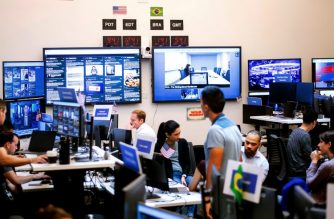 "Employees work in Facebook's ""War Room,"" during a media demonstration on October 17, 2018, in Menlo Park, California. - The freshly launched unit at Facebook's Menlo Park headquarters is the nerve center for the fight against misinformation and manipulation of the largest social network by foreign actors trying to influence elections in the United States and elsewhere. The war room, which will ramp up activity for the November 6 midterm US elections, is the most concrete sign of Facebook's efforts to weed out misinformation. (Photo by NOAH BERGER / AFP)"