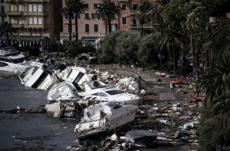 Destroyed yachts and boats lie in the harbour of Rapallo, near Genoa, on October 30, 2018, after a storm hit the region and destroyed a part of the dam the night before. - The fierce storms battering Italy caused nine dead in the night from October 29 to October 30, 2018. (Photo by MARCO BERTORELLO / AFP)