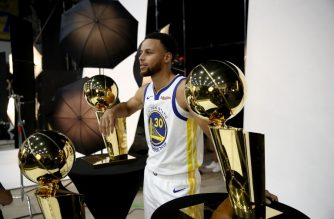 OAKLAND, CA - SEPTEMBER 24: Stephen Curry #30 of the Golden State Warriors poses with three Larry O'Brien NBA Championship Trophies during the Golden State Warriors media day on September 24, 2018 in Oakland, California.   Ezra Shaw/Getty Images/AFP