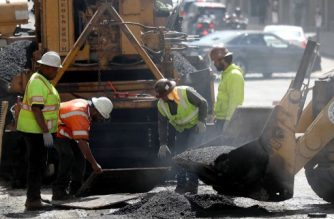 SAN FRANCISCO, CA - OCTOBER 05: Construction workers smooth tar as they pave a road on October 5, 2018 in San Francisco, California. Newly released data by the Labor Department on Friday shows that US employers added 134,000 jobs last month with hiring increases within construction, manufacturing and health care sectors. While this was below economists expectations of 185,000, it brought the unemployment rate down to 3.7 percent, the lowest since December 1969.   Justin Sullivan/Getty Images/AFP