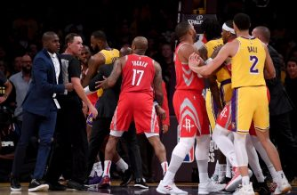 LOS ANGELES, CA - OCTOBER 20: Chris Paul #3 of the Houston Rockets is restrained by LeBron James #23 of the Los Angeles Lakers after a fight involving Rajon Rondo #9 and Brandon Ingram #14 of the Los Angeles Lakers during a 124-1115 Rockets win at Staples Center on October 20, 2018 in Los Angeles, California.   Harry How/Getty Images/AFP