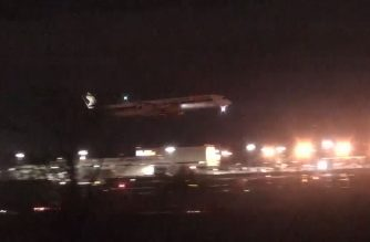 Singapore Airlines Flight SQ22 arriving at Newark Liberty International Airport at 05:29 am (09:29 GMT) after a nearly 18-hour trip from Singapore, completing the world's longest commercial flight (Source: photo grabbed from video of CBS provided by AFP)