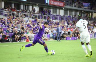 Orlando City forward Dom Dwyer attacks the ball while guarded by Sounders defender Nouhou Tolo. /Rob Potes/EBC Florida Bureau/Eagle News Service/