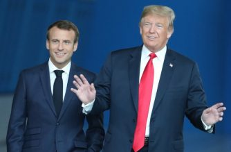 France's President Emmanuel Macron (L) arrives with to US President Donald Trump (R) for the NATO (North Atlantic Treaty Organization) summit, at the NATO headquarters in Brussels, on July 11, 2018. (Photo by Tatyana ZENKOVICH / POOL / AFP)