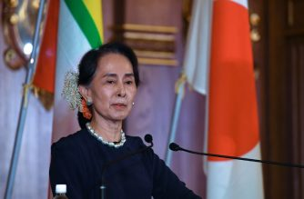 Myanmar's State Counsellor Aung San Suu Kyi delivers her speech during the joint press remarks with Japanese Prime Minister Shinzo Abe following their bilateral meeting at the Akasaka Palace state guest house in Tokyo on October 9, 2018. - Myanmar's State Counsellor Aung San Suu Kyi is in Tokyo to attend the 10th Mekong-Japan Summit. (Photo by Toshifumi KITAMURA / POOL / AFP)
