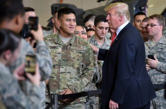 """(FILES) In this file photo taken on October 19, 2018, US President Donald Trump greets soldiers as he tours Luke Air Force Base in Phoenix, Arizona where he is for a """"Make America Great"""" rally. - US President Donald Trump said Wednesday, October 31, 2018 that as many as 15,000 soldiers could be dispatched to the US-Mexican border to stop what he described as dangerous groups of immigrants. With more than 5,000 soldiers already being sent, Trump told reporters """"we'll do up to anywhere between 10 and 15,000 military personnel."""" (Photo by Nicholas Kamm / AFP)"""