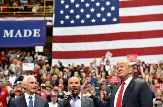 "Singer Lee Greenwood (C) performs alongside US President Donald Trump and US Vice President Mike Pence during a ""Make America Great Again"" campaign rally at McKenzie Arena, in Chattanooga, Tennessee on November 4, 2018. (Photo by Nicholas Kamm / AFP)"