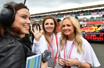 (FILES) In this file photo taken on July 10, 2016 Former singers from the British Band the Spice Girls, Geri Halliwell (C), and Emma Bunton (R) pose for a photograph as they stand with the Infiniti Red Bull racing team on the track ahead of the British Formula One Grand Prix at Silverstone motor racing circuit in Silverstone, central England. - The Spice Girls on Monday, November 5, 2018, released details of a 2019 UK reunion tour which will see them play Wembley Stadium, Britain's biggest venue, but without Victoria Beckham. (Photo by ANDREJ ISAKOVIC / AFP)