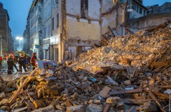 "This handout photo released by BMPM/SM shows firemEn and a dog searching at the site where two buildings collapsed, on November 5, 2018 in Marseille, southern France. - French rescue workers were searching into the night for possible victims under the wreckage of two dilapidated buildings that suddenly collapsed in the centre of Marseille. (Photo by Loic AEDO and HO / BMPM/SM Aedo / AFP) / RESTRICTED TO EDITORIAL USE - MANDATORY CREDIT ""AFP PHOTO / BMPM/SM / Loic AEDO"" - NO MARKETING NO ADVERTISING CAMPAIGNS - DISTRIBUTED AS A SERVICE TO CLIENTS ---"