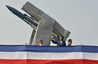 "Taiwan's President Tsai Ing-wen (C) waves to assembled guests from the deck of the 'Ming Chuan' frigate during a ceremony to commission two Perry-class guided missile frigates from the US into the Taiwan Navy, in the southern port of Kaohsiung on November 8, 2018. - President Tsai Ing-wen vowed on November 8 that Taiwan would not ""concede one step"" in defending itself as she inaugurated two frigates bought from the US aimed at boosting the island's naval capabilities against China threats. (Photo by Chris STOWERS / AFP)"