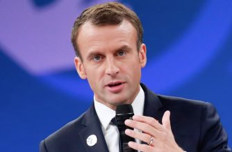 French President Emmanuel Macron gestures as he delivers a speech during the opening ceremony of the Paris Peace Forum at the Villette Conference Hall in Paris on November 11, 2018. - The Paris Peace Forum is a new annual event based on international cooperation and aimed at tackling global challenges and ensuring durable peace. (Photo by GONZALO FUENTES / POOL / AFP)