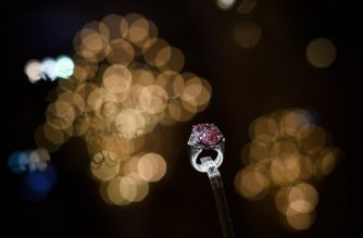 The Pink Legacy, a 18.96 carat fancy vivid pink diamond once owned by the Oppenheimer family, is seen after its sale at Christie's auction house on November 13, 2018, in Geneva, Switzerland. - An exceptionally rare 19-carat pink diamond has fetched USD 50 million (44 million euros) in Geneva on November 13, 2018, setting a new price-per-carat record for a stone of its kind, auction house Christie's said. (Photo by Fabrice COFFRINI / AFP)