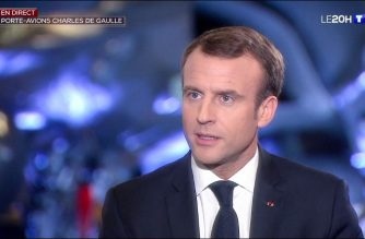 "This video grab from footage taken and released on November 14, 2018 by French television channel TF1 shows French President Emmanuel Macron speaking during a televised interview with the channel aboard the Charles de Gaulle aircraft carrier, off the coast of Toulon, southern France. (Photo by Handout / TF1 / AFP) / RESTRICTED TO EDITORIAL USE - MANDATORY CREDIT ""AFP PHOTO / TF1"" - NO MARKETING NO ADVERTISING CAMPAIGNS - DISTRIBUTED AS A SERVICE TO CLIENTS"