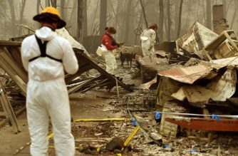 Tape marks an area where a body was found as rescue workers continue searching for human remains at a burned residence in Paradise, California, on November 14, 2018. - Firefighters backed by air tankers and helicopters battled California's raging wildfires for a seventh day on Wednesday as the authorities in the worst-hit county released a list of over 100 missing people. At least 51 deaths have been reported so far from the deadliest wildfires in California's recent history and body recovery teams were going house-to-house with cadaver dogs in Paradise. (Photo by Josh Edelson / AFP)