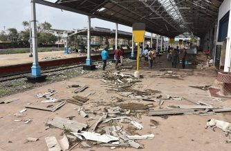 Debris from a damaged roof is pictured on a platform at the train station in Nagapattinam in India's southern Tamil Nadu state on November 16, 2018, after a cyclone struck the region. - Powerful winds felled trees, destroyed homes and forced thousands to flee to safety as Cyclone Gaja barrelled into India's eastern coast November 16. (Photo by - / AFP)