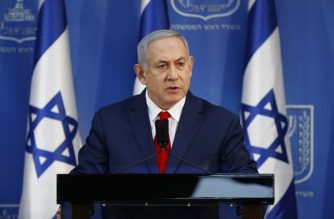 """Israeli Prime Minister Benjamin Netanyahu speaks in a televised address to the nation in the coastal city of Tel Aviv on November 18, 2018. - Netanyahu said  calling snap elections now would be """"irresponsible"""" as he vowed to push on despite a coalition crisis. (Photo by Jack GUEZ / AFP)"""