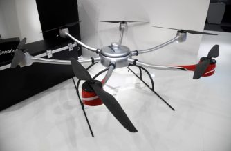 This photo taken on October 17, 2018 shows a DrN 15 drone at the Singapore Technologies Aerospace in Singapore. - Hi-tech Singapore is planning to roll out a swarm of drones for tasks that include delivering parcels, inspecting buildings and providing security, but safety and privacy concerns mean the initiative may hit turbulence. (Photo by Roslan RAHMAN / AFP) / TO GO WITH STORY: Singapore-drones-technology, FOCUS by Martin ABBUGAO