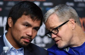"""(FILES) In this file photo taken on April 29, 2015, boxer Manny Pacquiao (L) talks with his trainer Freddie Roach during a news conference in Las Vegas, Nevada. - Roach has agreed to reunite with  Pacquiao for the Filipino fighter's bout with Adrien Broner in January, it was reported on November 21, 2018. A Sports Illustrated report, citing a text message from Roach, said he had agreed to work with Pacquiao again following late-night talks with the fighter on November 20. """"Manny reached out directly,"""" Roach was quoted as saying. """"We sat together one-on-one. I'll be in his corner Jan 19."""" (Photo by Ethan Miller / GETTY IMAGES NORTH AMERICA / AFP)"""