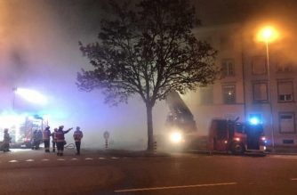 """This handout picture released by the Solothurn county police shows firemen next to a building were six people, including children, perished when a fire broke out in an apartment building in the northwestern Swiss town of Solothurn on early November 26, 2018. - """"There were more than 20 people in the building. Most were evacuated by the fire brigade, but for six people, including children, the help came too late,"""" Solothurn police said in a statement. (Photo by HO / Polizei Kanton Solothurn / AFP) / RESTRICTED TO EDITORIAL USE - MANDATORY CREDIT """"AFP PHOTO / Solothurn county police"""" - NO MARKETING NO ADVERTISING CAMPAIGNS - DISTRIBUTED AS A SERVICE TO CLIENTS ---"""