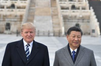 """(FILES) In this file photo taken on November 8, 2017, US President Donald Trump, and Chinese President Xi Jinping pose at the Forbidden City in Beijing. - There is a """"good possibility"""" President Donald Trump will reach an agreement later this week to resolve the US trade dispute with China, a White House official said November 27, 2018. Economic advisor Larry Kudlow told a media briefing """"the president said there is a good possibility that we can make a deal and he is open to it.""""Trump is due to meet Chinese leader Xi Jinping in Buenos Aires later this week on the sidelines of the Group of 20 summit. (Photo by Jim WATSON / AFP)"""