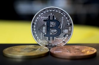 """A picture taken on February 6, 2018 shows a visual representation of the digital crypto-currency Bitcoin, at the """"Bitcoin Change"""" shop in the Israeli city of Tel Aviv. (Photo by JACK GUEZ / AFP)"""
