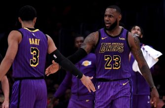 LOS ANGELES, CA - NOVEMBER 14: LeBron James #23 of the Los Angeles Lakers celebrates his basket with Josh Hart #3 during a 126-117 Laker win at Staples Center on November 14, 2018 in Los Angeles, California. NOTE TO USER: User expressly acknowledges and agrees that, by downloading and or using this photograph, User is consenting to the terms and conditions of the Getty Images License Agreement.   Harry How/Getty Images/AFP